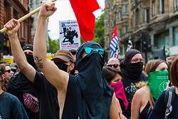"""Anti-fascist counter protesters march through the streets towards where several hundred protesters are gathered at Langham Place in central London demanding the release of """"political prisoner"""" right wing talisman Stephen Yaxley-Lennon  - also known as Tommy Robinson, who was imprisoned for contempt of court. London, August 03 2019."""