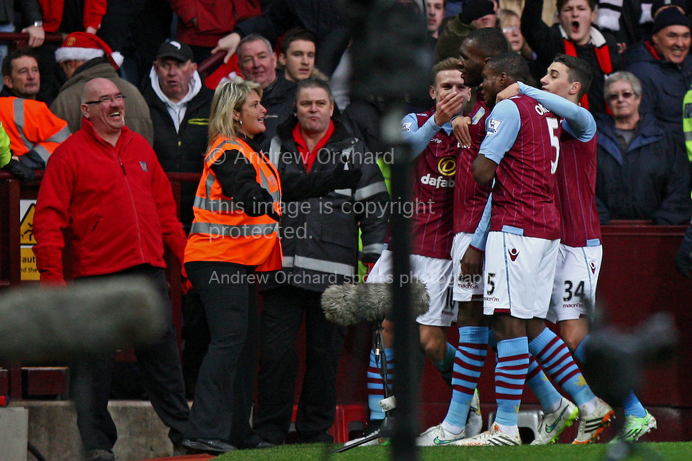 A steward appears to offer a hug to goalscorer Christian Benteke of Aston Villa after Benteke scores his teams 1st goal. Barclays Premier league match, Aston Villa v Manchester Utd at Villa Park in Birmingham on Saturday 20th December 2014<br /> pic by Mark Hawkins, Andrew Orchard sports photography.