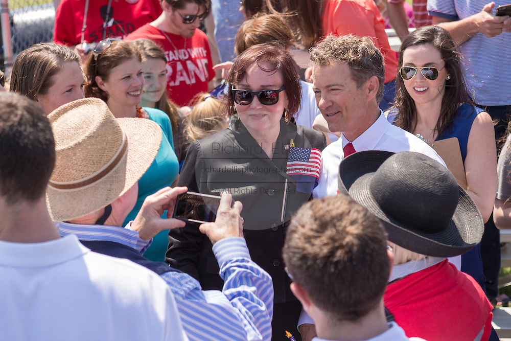 GOP presidential hopeful Senator Rand Paul greets supporters following a campaign rally in front of the aircraft carrier USS Yorktown on April 9, 2015 in Mt Pleasant, South Carolina.  Paul outlined a foreign policy vision built both on a strong military and a commitment to use it sparingly.