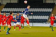 Scotland Captain Connor Smith (C)(Heart of Midlothian) headers the ball forward during the U17 European Championships match between Portugal and Scotland at Simple Digital Arena, Paisley, Scotland on 20 March 2019.
