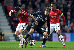 (left-right) Manchester United's Ander Herrera, CSKA Moscow's Konstantin Kuchaev, and Manchester United's Antonio Valencia battle for the ball