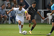 Auckland City FC's Cam Howieson is tackled by Hawke's Bay United's Karan Mandaie in the Handa Premiership football match, Hawke's Bay United v Auckland City FC, Bluewater Stadium, Napier, Sunday, January 31, 2021. Copyright photo: Kerry Marshall / www.photosport.nz