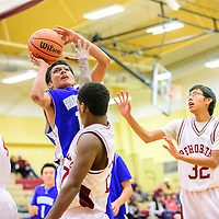 011215  Adron Gardner/Independent<br /> <br /> Navajo Pine Warrior Keenan Nez (12) takes a jump shot surrounded by the Rehoboth Lynx  at Rehoboth High School Monday.
