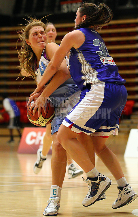 PERTH, AUSTRALIA - JULY 16: Jasmine Hooper of the Tigers gets fouled by Gabby Clayton of the Hawks during the week 18 SBL game between the Perry Lakes Hawks and the Willetton TIgers at The State Basketball Center on July 16, 2011 in Perth, Australia.  (Photo by Paul Kane/Allsports Photography)