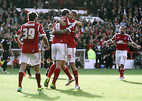 Nottingham Forest's Henri Lansbury (right) celebrates scoring the opening goal with teammates Nottingham Forest's Djamel Abdoun (left) and Nottingham Forest's Darius Henderson<br /> <br /> Photo by Rich Linley/CameraSport<br /> <br /> Football - The Football League Sky Bet Championship - Nottingham Forest v Bournemouth - Saturday 19th October 2013 - The City Ground - Nottingham<br /> <br /> © CameraSport - 43 Linden Ave. Countesthorpe. Leicester. England. LE8 5PG - Tel: +44 (0) 116 277 4147 - admin@camerasport.com - www.camerasport.com