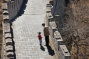 Father with his daughter on the Great Wall of China at Mutianyu, north of Beijing (formerly Peking), China