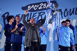 Manchester City manager Pep Guardiola with the trophy on stage during the celebrations at the Etihad Stadium after securing the Premier League title earlier in the day with their win at Brighton and Hove Albion.
