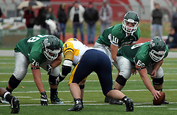 18 October 2014: Garret Laflamme, Rafael Rodriguez II, Niall Mulcahy, and Donovan Laible take their places around the line of scrimmage  during an NCAA division 3 football game between the Augustana Vikings and the Illinois Wesleyan Titans in Tucci Stadium on Wilder Field, Bloomington IL