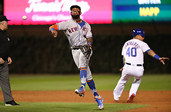 September 12, 2017 - Chicago, IL, USA - New York Mets second baseman Jose Reyes throws to first base to complete a double play after tagging Chicago Cubs baserunner Willson Contreras (40), then throwing out batter Ian Happ in the first inning at Wrigley Field in Chicago on Tuesday, Sept. 12, 2017. (Credit Image: © Chris Sweda/TNS via ZUMA Wire)