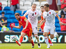 CARDIFF, WALES - Saturday, June 5, 2021: Wales' Joe Allen (L) is fouled by Albania's Ardian Ismajli during an International Friendly between Wales and Albania at the Cardiff City Stadium in their game before the UEFA Euro 2020 tournament. (Pic by David Rawcliffe/Propaganda)