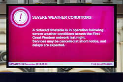 © Licensed to London News Pictures. 24/12/2013. London, UK. A warning sign explaining that British Rail services are experiencing disruption as a result of adverse weather conditions. Photo credit : Richard Isaac/LNP