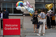 Friends and family of Hillary Chung, a 21 year-old Law graduate from Hong Kong, celebrate her graduation with a 2:1 degree outside the London School of Economics LSE after her graduation ceremony, on 22nd July 2019, in London, England.