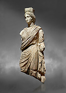 Roman statue of Tyche. Marble. Perge. 2nd century AD. Inv no 3062 . Antalya Archaeology Museum; Turkey.  Against a grey background<br /> <br /> A Tyche; was the presiding tutelary deity who governed the fortune and prosperity of a city; its destiny. In Classical Greek mythology; she is the daughter of Aphrodite and Zeus or Hermes. .<br /> <br /> If you prefer to buy from our ALAMY STOCK LIBRARY page at https://www.alamy.com/portfolio/paul-williams-funkystock/greco-roman-sculptures.html . Type -    Antalya     - into LOWER SEARCH WITHIN GALLERY box - Refine search by adding a subject, place, background colour, museum etc.<br /> <br /> Visit our ROMAN WORLD PHOTO COLLECTIONS for more photos to download or buy as wall art prints https://funkystock.photoshelter.com/gallery-collection/The-Romans-Art-Artefacts-Antiquities-Historic-Sites-Pictures-Images/C0000r2uLJJo9_s0