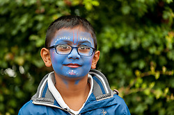© Licensed to London News Pictures. 05/09/2015. Watford, UK. A young boy wears blue face-paint in the guise of Lord Krishna at the biggest Janmashtami festival outside of India at the Bhaktivedanta Manor Hare Krishna Temple in Watford, Hertfordshire.  The event celebrates the birth of Lord Krishna and the festival  includes music, dance, food, dramas and more. Photo credit : Stephen Chung/LNP
