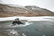 A jeep making its way through a river. Driving down from Sarhad village, end of the road in the Wakhan corridor, to Ishkashim town, on the Tajikistan border.