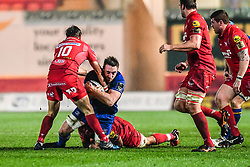 Leinster's Jack Conan is tackled by Scarlets' Tadhg Beirne<br /> <br /> Photographer Craig Thomas/Replay Images<br /> <br /> Guinness PRO14 Round 17 - Scarlets v Leinster - Friday 9th March 2018 - Parc Y Scarlets - Llanelli<br /> <br /> World Copyright © Replay Images . All rights reserved. info@replayimages.co.uk - http://replayimages.co.uk