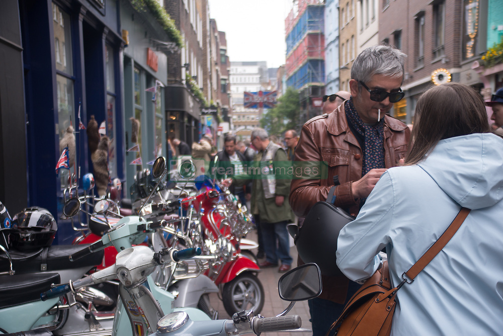 April 30, 2017 - London, Central London, United Kingdom - The Mods are pictured while gather with their scooters at Carnaby Street. Tens of Italian scooters appeared at the world famous Carnaby Street, to celebrate the Mod culture with pimped Italian Vespa and Lambretta scooters, traditional suits and the iconic parkas. (Credit Image: © Alberto Pezzali/Pacific Press via ZUMA Wire)