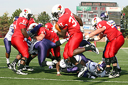 05 November 2011:  Darrelynn Dunn makes his way to the end zone behind the blocking of Keenan Wimbley during an NCAA football game between the Western Illinois Leathernecks and the Illinois State Redbirds at Hancock Stadium in Normal IL