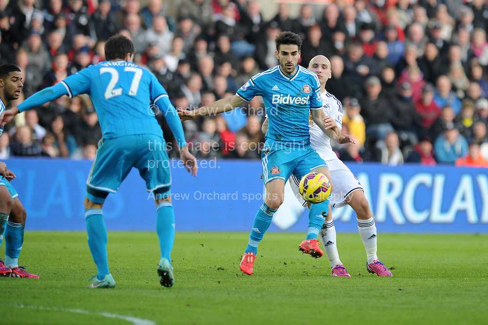 Jordi Gomez of Sunderland holds off Swansea's Jonjo Shelvey.  Barclays premier league match, Swansea city v Sunderland at the Liberty stadium in Swansea, South Wales on Saturday 7th Feb 2015.<br /> pic by Andrew Orchard, Andrew Orchard sports photography.