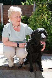 Woman with visual impairment with guide dog.