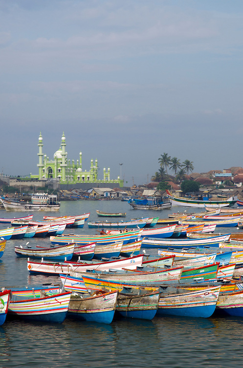 Fishing boats with Vizhinjam mosque in the background, Kerala, South India