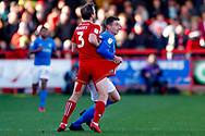 Accrington Stanley defender Mark Hughes (3) has his shorts held by Portsmouth forward Oliver Hawkins (9)  during the EFL Sky Bet League 1 match between Accrington Stanley and Portsmouth at the Fraser Eagle Stadium, Accrington, England on 27 October 2018.