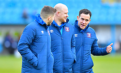 Carlisle United's Luke Joyce (right) speaks to team mates ahead of the match