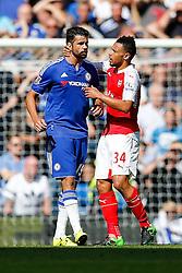Francis Coquelin of Arsenal tries to calm down Diego Costa of Chelsea - Mandatory byline: Rogan Thomson/JMP - 07966 386802 - 19/09/2015 - FOOTBALL - Stamford Bridge Stadium - London, England - Chelsea v Arsenal - Barclays Premier League.