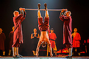 """A monk does a headstand on his finger tips - Twenty Shaolin monks, from their  temple in the foothills of the Song Shang mountain range in China's Henan province, take to the stage to demonstrate their martial arts expertise in an 'awe-inspiring' performance. SHAOLIN is a display of theatre and physical prowess in which the cast perform """"superhuman"""" feats. The show combines traditional Shaolin Kung Fu, inch perfect choreography with dramatic lighting and sound that evokes the spirit of their tradition – their Temple being the birthplace of Kung Fu.  These are the very best Shaolin Kung Fu experts on the planet and they have come together to create this show. The Shaolin Monks are lifted aloft on sharpened spears, break marble slabs with their heads, perform handstands on two finger tips,splinter wooden staves with their bodies, break bricks on their heads and fly through the air in a series of incredible back flips. The show embarks upon a three-week run at The Peacock Theatre, London from 29 September – 17 October 2015."""