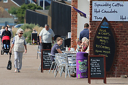 © Licensed to London News Pictures. 10/09/2015. East Sussex.  People on the Bexhill seafront. The country has enjoyed high temperatures and sunny weather today as summer draws to a close. Credit : Rob Powell/LNP