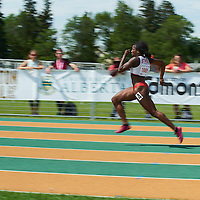 Shyvonne Roxborough (lane 4) advances to the next round in the Junior Women's 100m with a time of 11.82