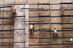 Workers help to build a supermarket in an upscale part of Caracas.  After two years of economic downturn Venezuela's economy has showed some resurgence in the first half of 2004.  Though underneath the surface it is more difficult to determine if the growth will be sustained.  One of the sectors that has shown growth has been construction,.