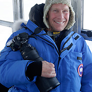 Dr. Steve Amstrup on a Tundra Buggy watching and photographing polar bears. Canada