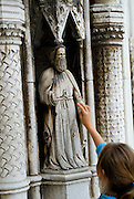 Child touching stonework, main portal, Cathedral of Saint Jacob (Sveti Jakova), Sibenik, Croatia. Sometimes also referred to as Cathedral of Saint James.