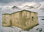 Only mosque in the Little Pamir (and highest one in Afghanistan!), built by Haji Osman, and used in the spring/autumn camp..On the way to Wakhjir valley, source of the Oxus river..Winter expedition through the Wakhan Corridor and into the Afghan Pamir mountains, to document the life of the Afghan Kyrgyz tribe. January/February 2008. Afghanistan