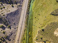 Aerial view of sevier blue river following the road in Hatch, Utah, USA.