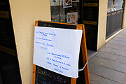 Sign outside bakers - max 2 people at a time, take away only, Empty streets in Sant Cugat del Valles, a normally bustling city of some 90,000 people outside Barcelona, on the day before Spain exerted a state of Emergency to deal with the spread Coronavirus. Spain is one of the worst affected countries. Schools and retail businesses are closed, except for supermarkets and pharmacies.
