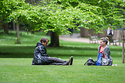 Two people are pictured in different perspective while spending their afternoon at St James' Park in London, Britain, on Sunday, May 3, 2020. Britons are now in their sixth week of lockdown due to the Coronavirus pandemic. Countries around the world are taking increased measures to stem the widespread of the SARS-CoV-2 coronavirus which causes the Covid-19 disease. (Photo/ Vudi Xhymshiti)