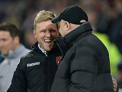 Bournemouth Manager, Eddie Howe laughs as he speaks to Cardiff City Manager, Russell Slade - Photo mandatory by-line: Alex James/JMP - Mobile: 07966 386802 - 17/03/2015 - SPORT - Football - Cardiff - Cardiff City Stadium - Cardiff City v AFC Bournemouth - Sky Bet Championship
