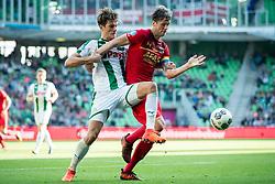 (L-R) Etienne Reijnen of FC Groningen, Wout Weghorst of AZ during the Dutch Eredivisie match between FC Groningen and AZ Alkmaar at Noordlease stadium on October 15, 2017 in Groningen, The Netherlands