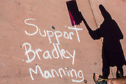 """06 JUNE 2012 - PHOENIX, AZ:   A protester speaks in support of US Army PFC Bradley Manning in Phoenix Wednesday. About 10 people gathered on a street corner in central Phoenix Wednesday to support Manning, who been criminally charged for passing secrets in the """"wikileaks"""" case and is awaiting trial in a US Army jail.      PHOTO BY JACK KURTZ"""