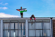 Birmingham, United Kingdom, June 14, 2021: Palestine Action activist appears to be using a sledgehammer to break the windows of an admin office facility owned by Arconic industrial manufacturer in Birmingham on Monday, June 14, 2021 - after they 'occupied the site claiming the company 'provided cladding for Grenfell Tower' and 'materials for Israel's fighter jets.' (Photo by Vudi Xhymshiti)