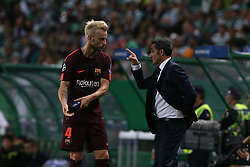 September 27, 2017 - Lisbon, Lisbon, Portugal - Barcelonas midfielder Ivan Rakitic from Croatia (L) and Barcelonas head coach Ernesto Valverde from Spain (R) during the match between Sporting CP v FC Barcelona UEFA Champions League playoff match at Estadio Jose Alvalade on September 27, 2017 in Lisbon, Portugal. (Credit Image: © Dpi/NurPhoto via ZUMA Press)