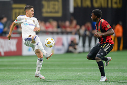 September 22, 2018 - Atlanta, GA, U.S. - ATLANTA, GA Ð SEPTEMBER 22:  Real Salt Lake's Jefferson Savarino (7) settles the ball in front of Atlanta's George Bello (right) during the match between Atlanta United and Real Salt Lake on September 22nd, 2018 at Mercedes-Benz Stadium in Atlanta, GA.  Atlanta United FC defeated Real Salt Lake by a score of 2 to 0.  (Photo by Rich von Biberstein/Icon Sportswire) (Credit Image: © Rich Von Biberstein/Icon SMI via ZUMA Press)
