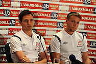 Wales players Joe Allen (l) and Chris Gunter (r). Wales football players media session at St.Davids Hotel in Cardiff on Tuesday 4th Sept 2012, the Welsh players talk about their forthcoming World cup qualifier against Belgium on Friday 8th Sept.  pic by  Andrew Orchard, Andrew Orchard sports photography,
