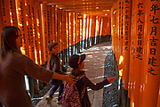 The Fushimi Inari Shrine is a Shinto shrine famous for its thousands of vermilion torii which straddle a network of trails behind its main buildings. They lead into a wooded forest on the slopes of sacred Mount Inari.
