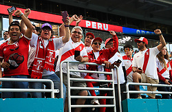 March 23, 2018 - Miami Gardens, Florida, USA - Peruvian fans cheer for the camera as they anticipate the FIFA 2018 World Cup preparation match between the Peru National Soccer Team and the Croatia National Soccer Team at the Hard Rock Stadium in Miami Gardens, Florida. (Credit Image: © Mario Houben via ZUMA Wire)