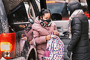 17 FEBRUARY 2021 - DES MOINES, IOWA:  A student gets out of her parents' car at Walnut Street School in downtown Des Moines. Des Moines Public Schools (DMPS) opened to in person education this week after teaching most of the 2020-2021 school year either remotely or with a hybrid/remote learning model. The district has ended its hybrid model. The Governor of Iowa has aggressively pushed schools to return to in person education, going so far as to threaten to withhold funds from districts that don't return to in person classes. DMPS, the largest school district in Iowa, has resisted the Governor's push because Polk County, IA, has been a Coronavirus/COVID-19 hotspot with positivity rates well above 10 percent. The district was recently able to vaccinate many teachers and positivity rates have fallen to 9 percent, making it safer to reopen schools.PHOTO BY JACK KURTZ