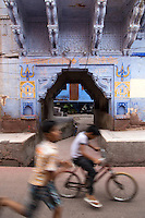 """Indian kids playing on the streets of Jodhpur which is often called the """"blue city"""". Today Jodhpur is a popular tourist destination set near the austere Thar desert.  Jodhpur is called the """"Blue City"""" thanks to the vivid blue painted houses around Mehrangarh Fort."""