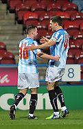 Harry Bunn (30) of Huddersfield Town (left) is congratulated on his goal against Reading during the Sky Bet Championship match at the John Smiths Stadium, Huddersfield<br /> Picture by Graham Crowther/Focus Images Ltd +44 7763 140036<br /> 03/01/2015